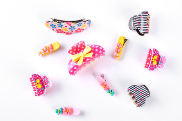 Collection of fashion hair clips. Set of different hairpins for little girls on white background.