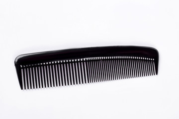 Black barber comb, white background. Simple plastic brush isolated on white background. Hairdresser professional comb instrument.