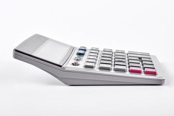 Plastic electronic calculator on white background. New silver calculator isolated on white background.