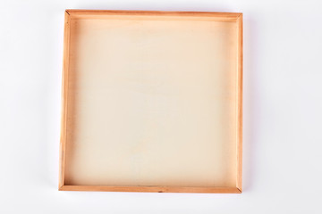 Blank wooden frame, white background. Wooden picture frame isolated on white background.