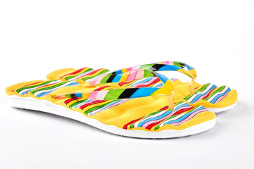 New fashion slippers for woman. Beautiful yellow flip flops for sea vacation. Summer holiday concept.
