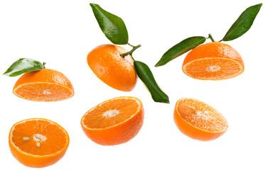Wall Mural -   Halves of tangerines in air.