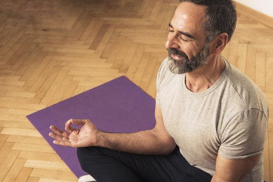 Senior mature man practicing yoga