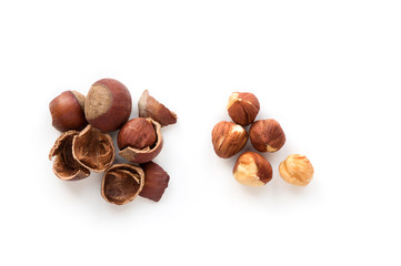 Isolated roasted hazelnuts.