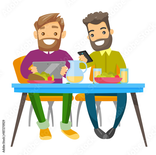 two young caucasian white men sitting together at the table with