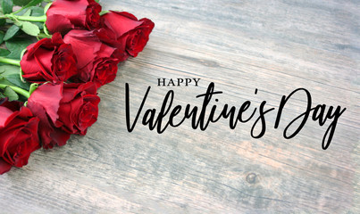 Happy Valentine's Day Calligraphy with Rose Bouquet Over Rustic Wood Background