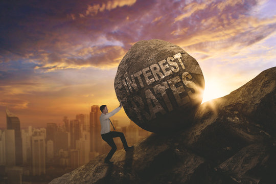 European businessman pushing text of interest rates