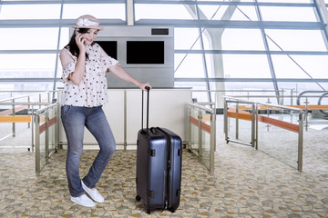 Caucasian woman talking on the smartphone at airport