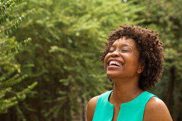 Young happy African American woman smiling.