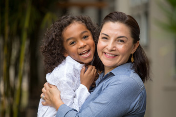 Hispanic mother and her daughter.
