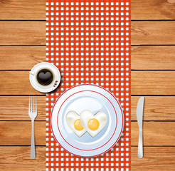 heart-shaped fried eggs on white plate and coffee cup