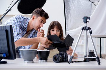 Young photographer working in photo studio