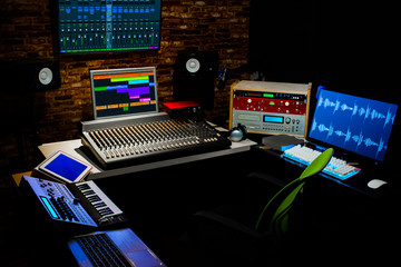 professional digital recording equipment in sound studio. music, recording, editing, broadcasting concept background