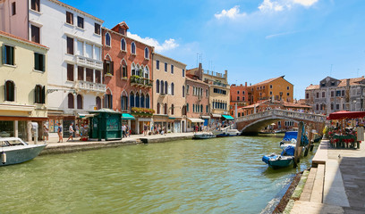 Venice, Italy - August 14, 2017: Venice canal with boats and classic buildings.