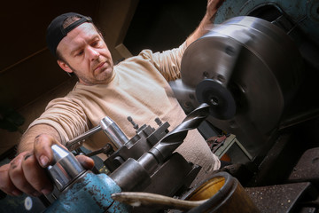 Metal worker working on lathe