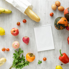 Top view set raw food notebook wooden background Healthy food