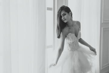 girl in a white dress. bride. black-and-white photo.