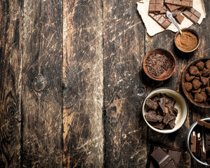 Chocolate bars with truffles and cocoa powder.