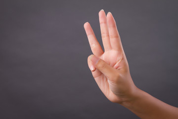 hand pointing up 3 finger gesture