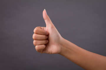 hand showing thumb up, like, good, approval, acceptance, okay, ok, positive gesture