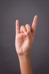 hand pointing up love or rock hand sign gesture