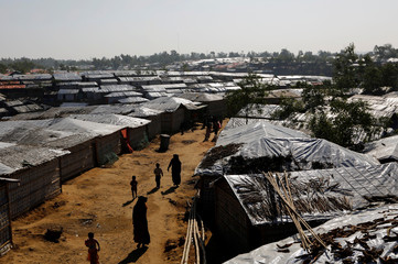 Rohingya refugees walk inside Kutupalong refugee camp near Cox's Bazar