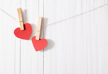 red paper heart on wooden background