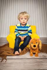 im Kindersessel sitzen
