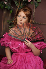 medieval lady in a pink dress with a fan