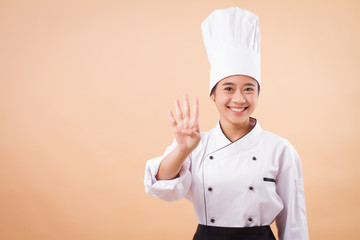 female asian chef pointing up four fingers gesture