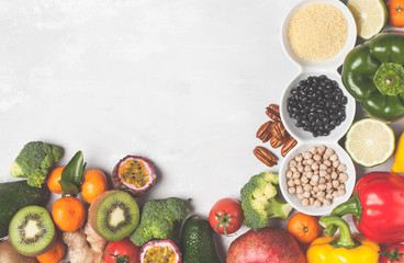 Healthy vegan food concept. Fruits vegetables background. Fresh vegetables, exotic and seasonal fruits, cereals, nuts and beans for a vegetarian diet, top view. Copy space, frame background.