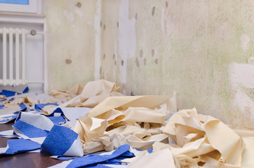 home repair concept, removed wallpaper on the floor, remodel apartment, selective focus