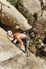 Rock climber ascending a steep granite crack in la Pedriza, Madrid