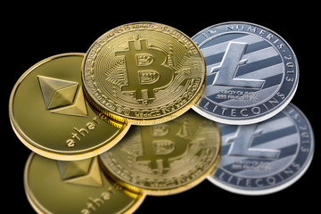 Bitcoin, ethereum and litecoin coins isolated on black background with reflection. Crypto currency electronic money for web banking and international network payment. Close up with selective focus.