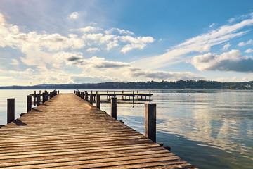 Empty wooden pier on Lake Starnberg in Bavaria, Germany