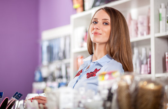 Saleswoman or assistant posing at beauty store, shopping cosmetic