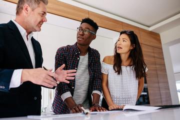 Interracial couple having consultation with a realtor