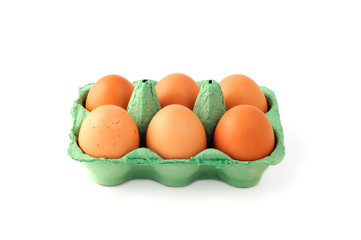 box of natural beige eggs on white isolated background