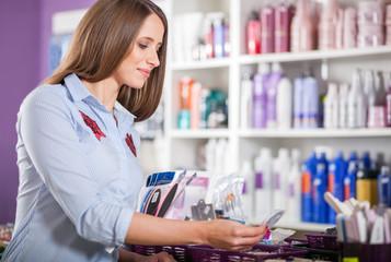 Customer woman choosing cosmetics at beauty store