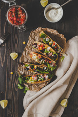 Mexican vegetarian tacos with salsa and avocado on the wooden background, top view. Copy space