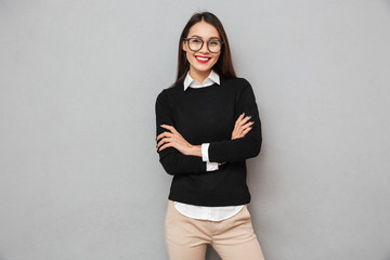 Cheerful asian woman in business clothes and eyeglasses Wall mural