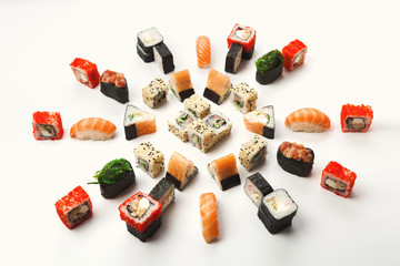 Set of sushi, maki and rolls on white background
