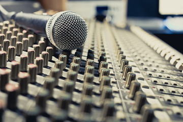 microphone on sound mixer, music background