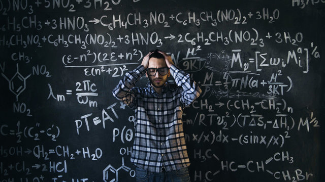 scientist man disappointed about problems experiment in chemical and mathematical equations room