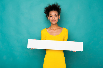 Young african-american woman holding blank banner