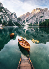 Poster Mountains Boats and slip construction in Braies lake with crystal water in background of Seekofel mountain in Dolomites in morning, Italy Pragser Wildsee