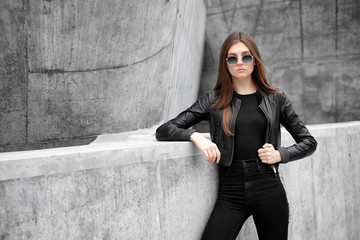 fashion portrait of young elegant woman outdoor.