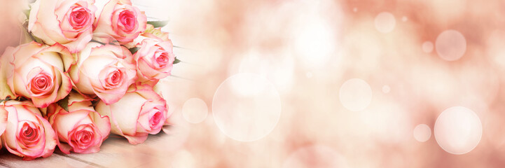 Bouquet of roses on pink bokeh background