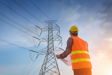 Engineering working on high-voltage tower