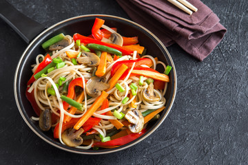 Stir fry with noodles and vegetables